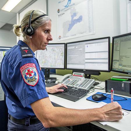 Paramedic at computer