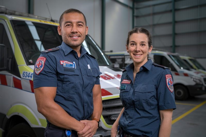 Two paramedics smiling at camera