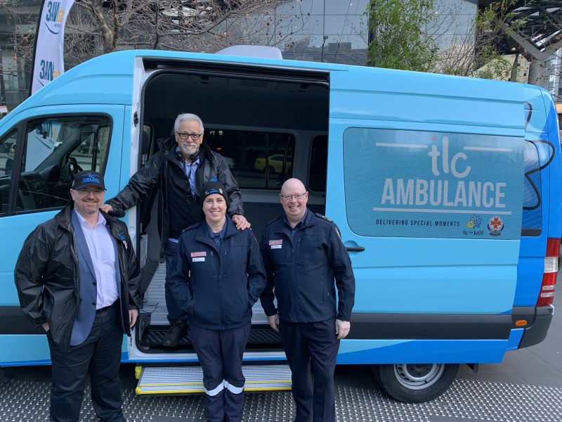 TLC for Kids CEO Tim Conolon, 3AW's Neil Mitchell, Ambulance Victoria paramedic Jemima Tawse and Ambulance Victoria CEO Associate Professor Tony Walker standing in front of the TLC Ambulance.
